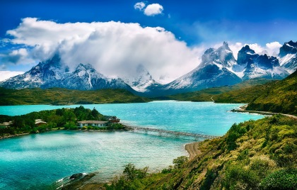 Bright blue lake with backdrop of mountains on Chile tour
