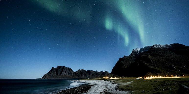 Aurora Borealis against mountain town