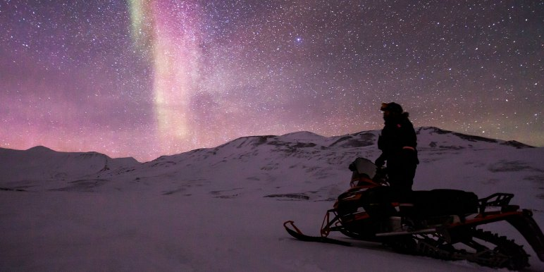 Snowmobile to see Northern Lights in the Arctic
