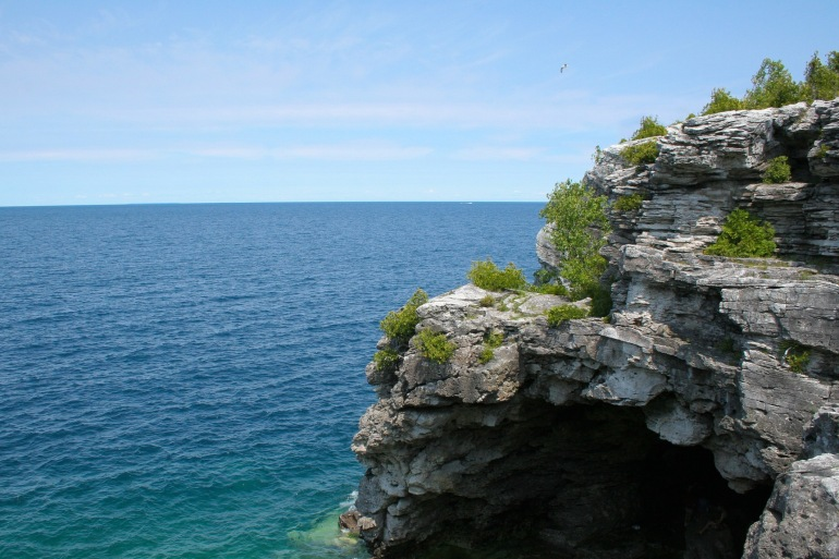 Shore lake cave cliff-United States-2677379_P