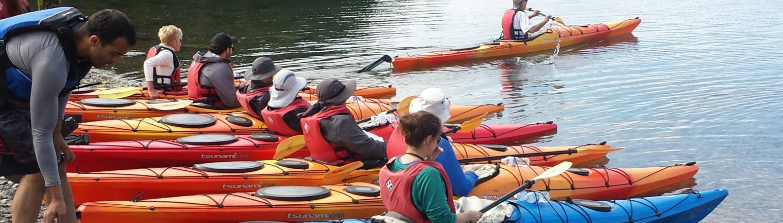 Group kayaking in river on Tofino Expeditions tour