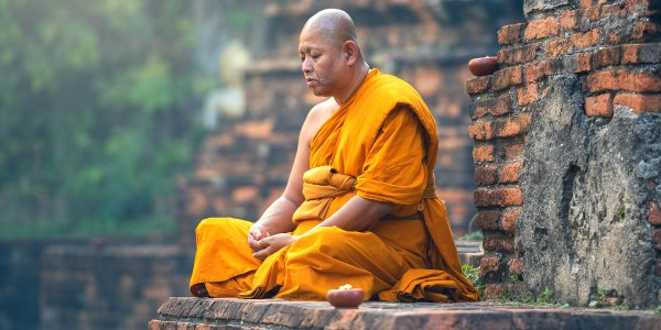 Monk mediating in Myanmar on tour with Intrepid Travel