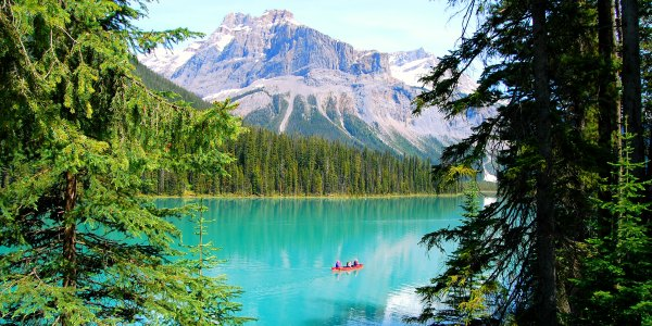 Red canoe on bright blue lake in Canada national park