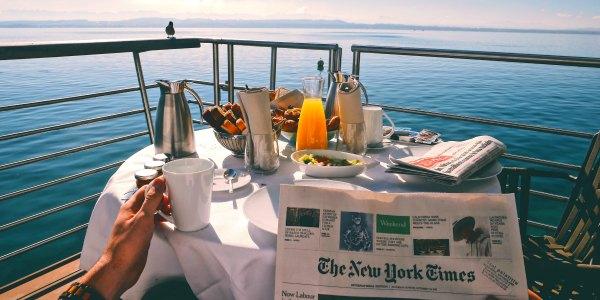 Enjoying breakfast and coffee on luxury river cruise in Europe
