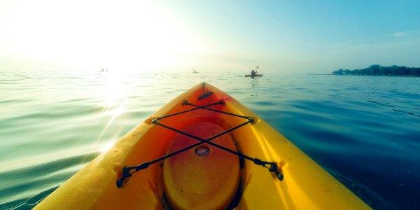 Sea kayaking at sunrise