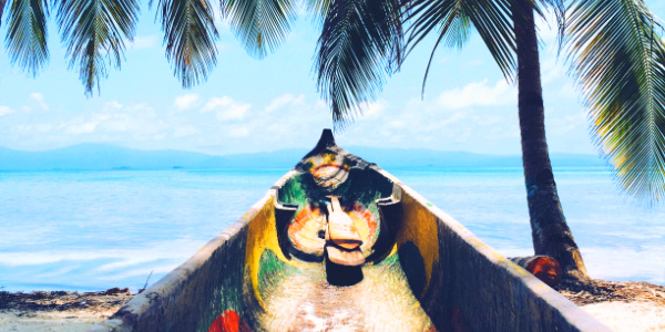 Relaxing palm trees and traditional asian boat