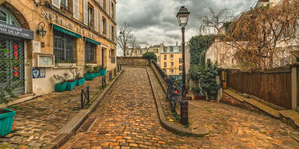 Local Paris street with guide on Monograms tour